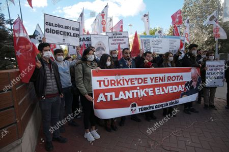 """Members of a Turkish group stage a protest near the U. S. Embassy in support of Turkey's President Recep Tayyip Erdogan, in Ankara, Turkey, . Erdogan last Saturday announced he ordered 10 ambassadors, including those from the US, Germany and France, be declared persona non grata, following a joint statement from the envoys calling for the release of Turkish activist Osman Kavala. The banner reads: """" New route at Turkey, farewell to the Atlantic"""