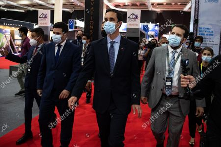 Chile's biminister of Mining and Energy, Juan Carlos Jobet (C), attends the Expomin mining fair, in Santiago, Chile, 25 October 2021. The Expomin fair, one of the main mining meetings in Latin America, started this 25 October in Chile, the country that produces the most copper in the world, at a time when the industry faces new challenges in environmental matters and just when the price of copper suffers swings. The fair will last five days in Santiago and expects more than 50,000 guests.