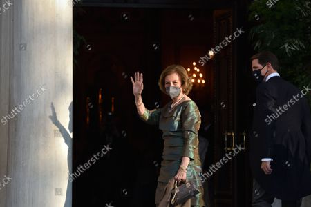 Queen Sofia of Spain arrives at the Metropolitan Cathedral of Athens for the wedding of Prince Philippos with Nina Flohr.