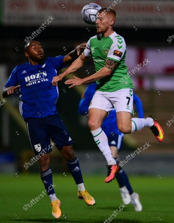 Matt Worthington of Yeovil Town challenges for the aerial ball with  Tyreke Johnson of Woking during the National League Match between Yeovil Town and Woking at Huish Park on 26 Oct, 2021 in Yeovil, England (Photo by Mat Mingo/PPAUK)