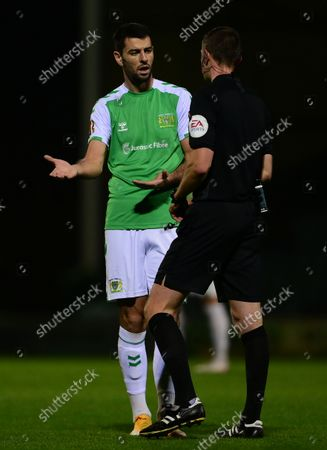 Joe Quigley of Yeovil Town is shown a yellow card from, Referee, Elliott Swallow during the National League Match between Yeovil Town and Woking at Huish Park on 26 Oct, 2021 in Yeovil, England (Photo by Mat Mingo/PPAUK)