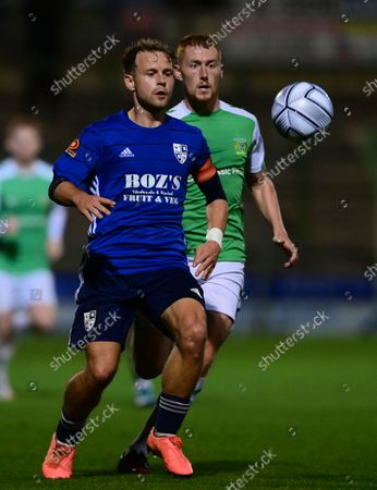 Josh Casey, Captain of Woking holds off  Matt Worthington of Yeovil Town during the National League Match between Yeovil Town and Woking at Huish Park on 26 Oct, 2021 in Yeovil, England (Photo by Mat Mingo/PPAUK)