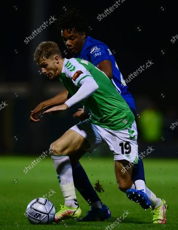 Charlie Wakefield of Yeovil Town battles for the ball with Kane Thompson-Sommers of Woking during the National League Match between Yeovil Town and Woking at Huish Park on 26 Oct, 2021 in Yeovil, England (Photo by Mat Mingo/PPAUK)