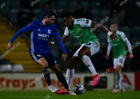 Adi Yussuf of Yeovil Town battles for the ball with  Max Kretzschmar of Woking during the National League Match between Yeovil Town and Woking at Huish Park on 26 Oct, 2021 in Yeovil, England (Photo by Mat Mingo/PPAUK)
