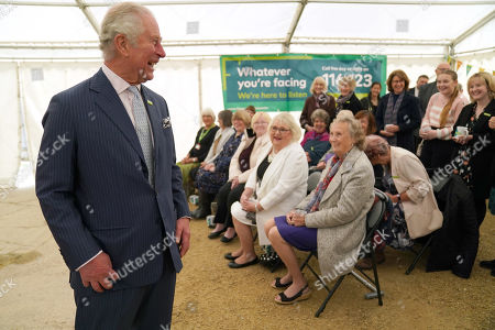 Prince Charles, Patron of Samaritans, speaking to volunteers during a visit to the Gloucester and District Branch of Samaritans in Gloucester, to celebrate their 50th Anniversary and hear about the recent work of the charity.