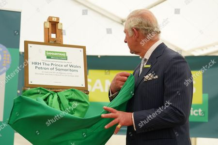 Prince Charles, Patron of Samaritans, unveiling a plaque during a visit to the Gloucester and District Branch of Samaritans in Gloucester, to celebrate their 50th Anniversary and hear about the recent work of the charity.