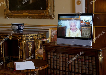 Queen Elizabeth II appears on a screen via videolink from Windsor Castle, where she is in residence, during a virtual audience at Buckingham Palace, London.