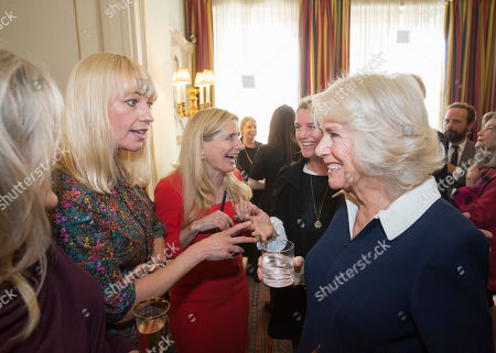 Camilla Duchess of Cornwall (right) speaks with author and BBC Radio 2 DJ Sara Cox at a reception hosted by The Duchess of Cornwall for 'The Duchess of Cornwall's Reading Room', a hub for literary communities around the world, which celebrates literature in all its forms. Inspired by the success of Her Royal Highness's reading lists shared during the pandemic in 2020, the Reading Room channel offers new seasons of book recommendations, as well as exclusive insight from the authors themselves, in a community space for book lovers of all ages, abilities and backgrounds.