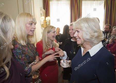 Stock Photo of Camilla Duchess of Cornwall (right) speaks with author and BBC Radio 2 DJ Sara Cox at a reception hosted by Camilla Duchess of Cornwall for 'The Duchess of Cornwall's Reading Room', a hub for literary communities around the world, which celebrates literature in all its forms. Inspired by the success of Her Royal Highness's reading lists shared during the pandemic in 2020, the Reading Room channel offers new seasons of book recommendations, as well as exclusive insight from the authors themselves, in a community space for book lovers of all ages, abilities and backgrounds.