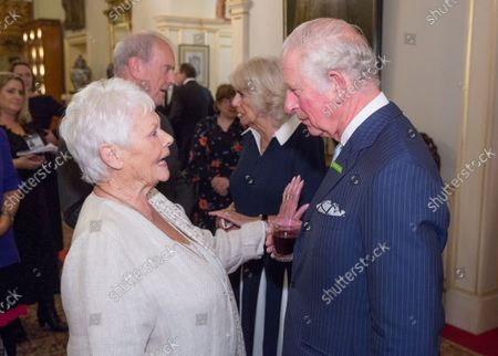 Prince Charles speaks with Dame Judy Dench at a reception hosted by Camilla Duchess of Cornwall for 'The Duchess of Cornwall's Reading Room', a hub for literary communities around the world, which celebrates literature in all its forms. Inspired by the success of Her Royal Highness's reading lists shared during the pandemic in 2020, the Reading Room channel offers new seasons of book recommendations, as well as exclusive insight from the authors themselves, in a community space for book lovers of all ages, abilities and backgrounds.