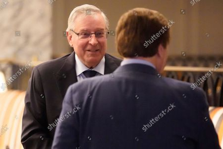 Terry Pegula, owner of the Buffalo Bills, arrives for an NFL football owners meeting in New York