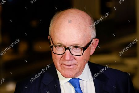 Stock Image of Woody Johnson, owner of the New York Jets, talks to reporters as he arrives for an NFL football owners meeting in New York