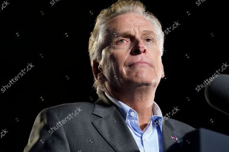 Democratic gubernatorial candidate former Virginia Gov. Terry McAuliffe pauses as he speaks during a rally, in Arlington, Va. McAuliffe will face Republican Glenn Youngkin in the November election
