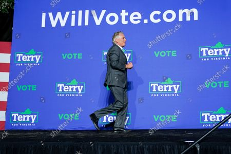 Democratic gubernatorial candidate former Virginia Gov. Terry McAuliffe arrives on stage to speak during a rally, in Arlington, Va. McAuliffe will face Republican Glenn Youngkin in the November election