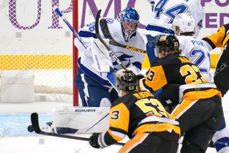 Tampa Bay Lightning goaltender Andrei Vasilevskiy (88) blocks a shot during the first period of an NHL hockey game against the Pittsburgh Penguins in Pittsburgh