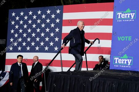 President Joe Biden walks on stage to speak at a rally for Democratic gubernatorial candidate, former Virginia Gov. Terry McAuliffe, in Arlington, Va. McAuliffe will face Republican Glenn Youngkin in the November election
