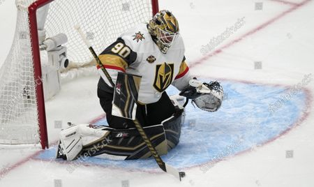 Stock Image of Vegas Golden Knights goalie Robin Lehner makes a stick save of a shot while facing the Colorado Avalanche in the first period of an NHL hockey game, in Denver