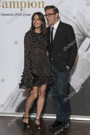 Stock Photo of Berenice Bejo and Michel Hazanavicius await the Lumiere Award Ceremony during the 13th Film Festival Lumiere In Lyon on October 15, 2021 in Lyon, France.