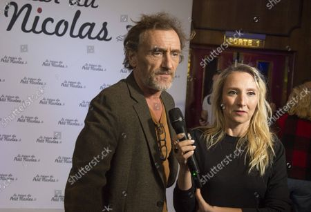 Stock Picture of Audrey Lamy and Jean Paul Rouvre at the premiere of the film The Treasure of Little Nicolas at the cinema Le Grand Rex in Paris, France on October 3, 2021