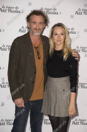 Audrey Lamy and Jean Paul Rouvre at the premiere of the film The Treasure of Little Nicolas at the cinema Le Grand Rex in Paris, France on October 3, 2021