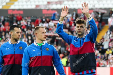 Stock Picture of Sergio Busquets, Marc-Andre Ter Stegen and Gerard Pique of FC Barcelona looks on during La Liga football match played between Rayo Vallecano and FC Barcelona at Vallecas stadium on October 27th, 2021 in Madrid, Spain.