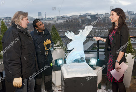 Philip Hughes, Asanga Amerasinghe and Christine Bleakley with Reindeer Ice Sculpture