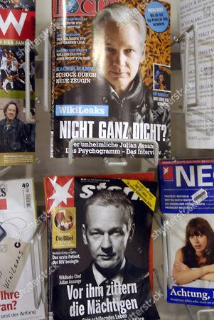 Wikileaks boss Julian Assange on cover of magazines on newsstand