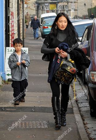 Stock Image of Alice Kim with son Kal-El Cage