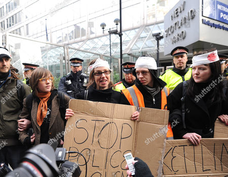 Susan Meadows (second left) mother of injured Alfie with protesters outside New Scotland Yard.