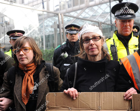 Stock Image of Susan Meadows (second left) mother of injured Alfie with protesters outside New Scotland Yard.