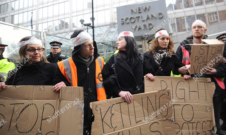 Editorial image of Protest organised by Susan Meadows, the mother of injured demonstrator Alfie Meadows, New Scotland Yard, London, Britain - 14 Dec 2010