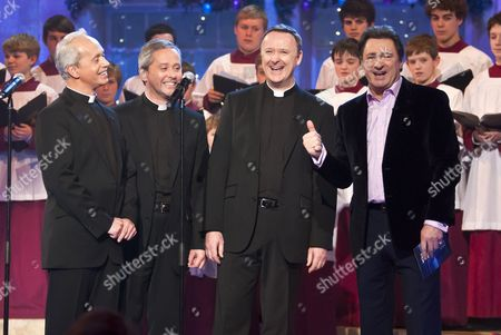 Stock Image of The Priests - Father Martin O'Hagen, Father Eugene O'Hagan and Father David Delargy with Alan Titchmarsh