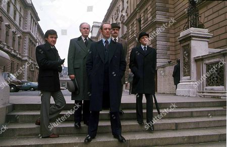 Willie Caine, as played by Ray Lonnen, Sir James Greenly, as played by Richard Vernon, Neil Burnside, as played by Roy Marsden, Matthew Peele, as played by Jerome Willis, Sir Geoffrey Wellingham - a British civil servant with Bowler hat and umbrella, as played by Alan MacNaughtan