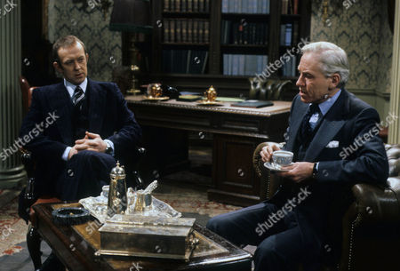 Stock Picture of Roy Marsden as Neil Burnside and Alan MacNaughtan as Sir Geoffrey Wellingham - a British Civil Servant with Bowler Hat and umbrella