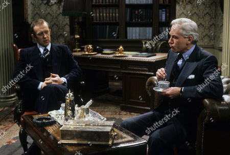 Stock Image of Roy Marsden as Neil Burnside and Alan MacNaughtan as Sir Geoffrey Wellingham - a British Civil Servant