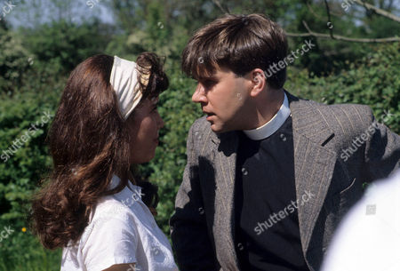 Abigail Rokison as Primrose and Tyler Butterworth as Reverend Candy