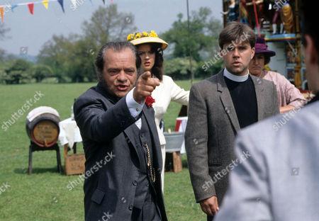 David Jason as Pop Larkin, Catherine Zeta-Jones as Mariette and Tyler Butterworth as Reverend Candy