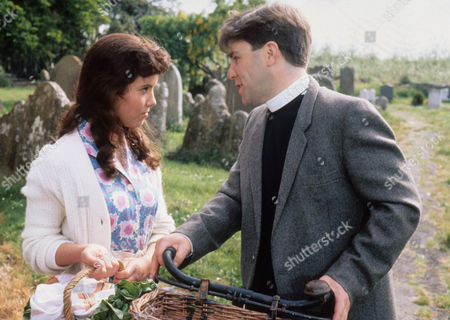 Stock Picture of Abigail Rokison as Primrose and Tyler Butterworth as Reverend Candy