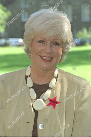 Stock Picture of Ann Keen. Gay Vote For Age To Be Dropped From 18 To 16.... Labour Party Mp Ann Keen Who Put Forward The Amendment To Parliament With Her Gay Son Mark Lloyd-fox 31 Who She Had To Give Up For Adoption At Birth She Was Only 17 Years Old. They Are Wearing Gay / Homosexual Equality Red Stars.. Group Picture..l To R... Chris Mums 18 David Cohen 16 Mark Lloyd-fox 31 M.p. Ann Keen And Antony Grey.......