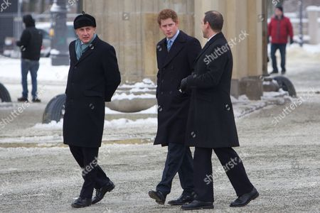 Prince Harry with Jamie Lowther-Pinkerton and British Ambassador Simon McDonald