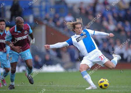 Luis Boa Morte of West Ham United watches on as Michel Salgado of  Blackburn Rovers shoots goalward