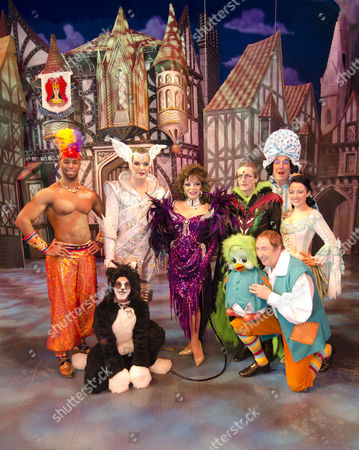 Jeremy Fontanet (Sultan), Julian Clary (Spirit of the Bells), Joan Collins (Queen Rat), Nigel Havers (King Rat), Jeffrey Holland (Dame Felicity Fitzwarren), Kathryn Rooney (Alice Fitzwarren) front: Lukas Alexander (Maureen the Cat), Keith Harris & Orville (The Rat Catchers)