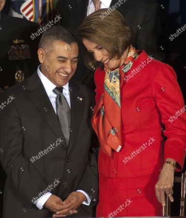 Stock Photo of Eric Alva, a former Marine and the first receipent of the Purple Heart during the second Iraq war, shares a smile with Speaker of the House, Nancy Pelosi, D-CA