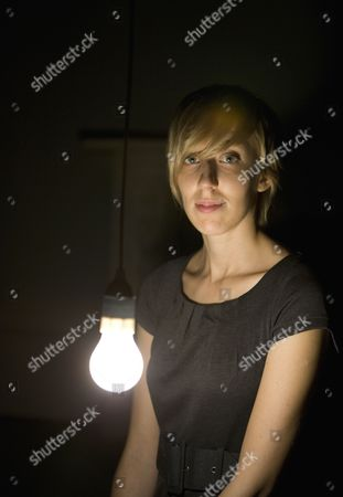 Artist Katie Paterson photographed with her 2008 work ' Light bulb to Simulate Moonlight ' at the Haunch of Venison Gallery in Central London.