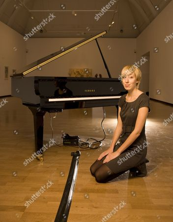 Artist Katie Paterson with her 2007 work ' Earth-Moon-Earth Moonlight Sonata Reflected from the Surface of the Moon '. Katie Paterson is photographed at the Haunch of Venison Gallery in Mayfair, London.