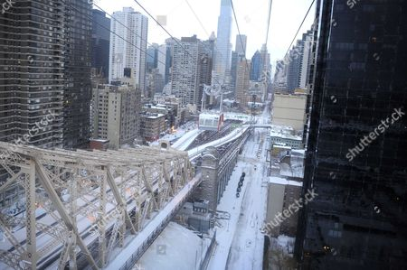 Stock Photo of View from the Roosevelt Island Tramway looking down upon 2nd Avenue and 59th street Queensborough bridge