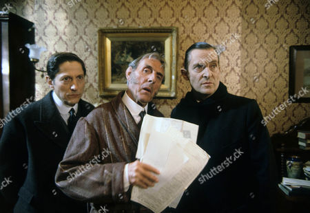 Stock Image of The Six Napoleans Picture shows - Colin Jeavons as Inspector Lestrade, Eric Sykes as Horace Harker and Jeremy Brett as Sherlock Holmes