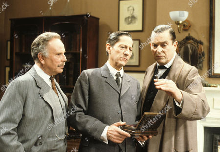 Stock Photo of The Creeping Man Picture shows - Edward Hardwicke as Dr Watson, Colin Jeavons as Inspector Lestrade and Jeremy Brett as Sherlock Holmes