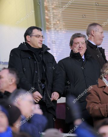 Liverpool Manager Roy Hodgson and Director of Football Strategy with Liverpool Damien Comolli watch the match