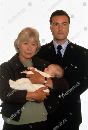 Picture shows - Nick Berry as PC Nick Rowan and baby Sarah/Katie, with Anne Stallybrass as Eileen Reynolds